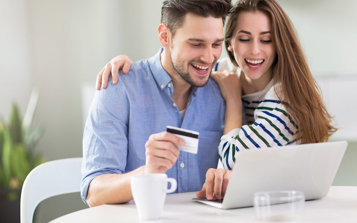 Couple looking on the laptop for a comprehensive guide to credit card consolidation