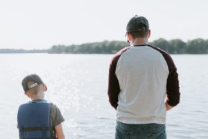 Father fishing with son