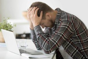 Frustrated man because insolvency expected to rise