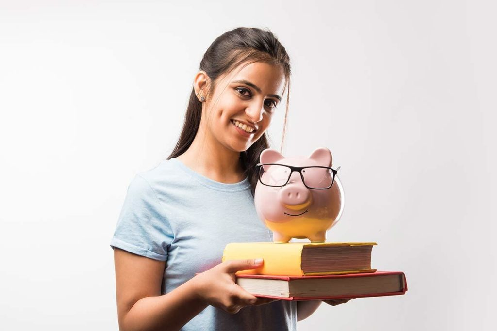 emale student holding piggy bank
