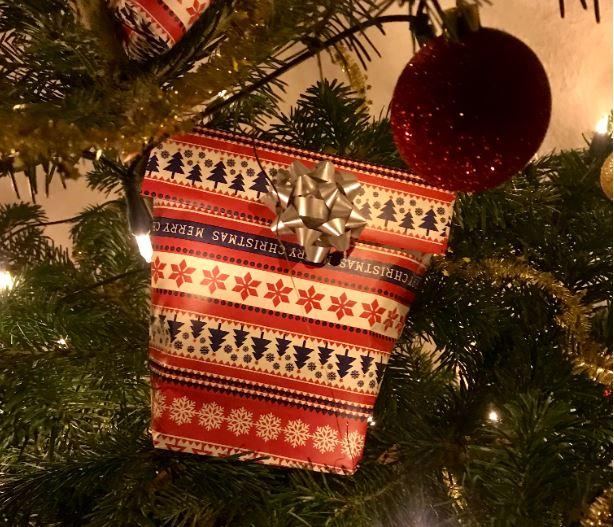 Christmas gift ornament on tree